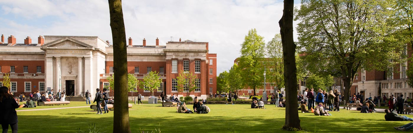 Samuel Alexander Building with students sat on grass in front