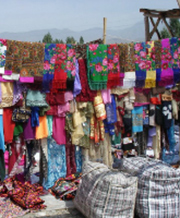 Brightly coloured clothing hanging outside