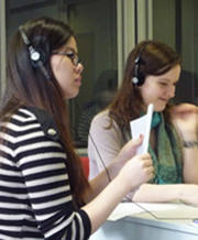 Students in translation booth